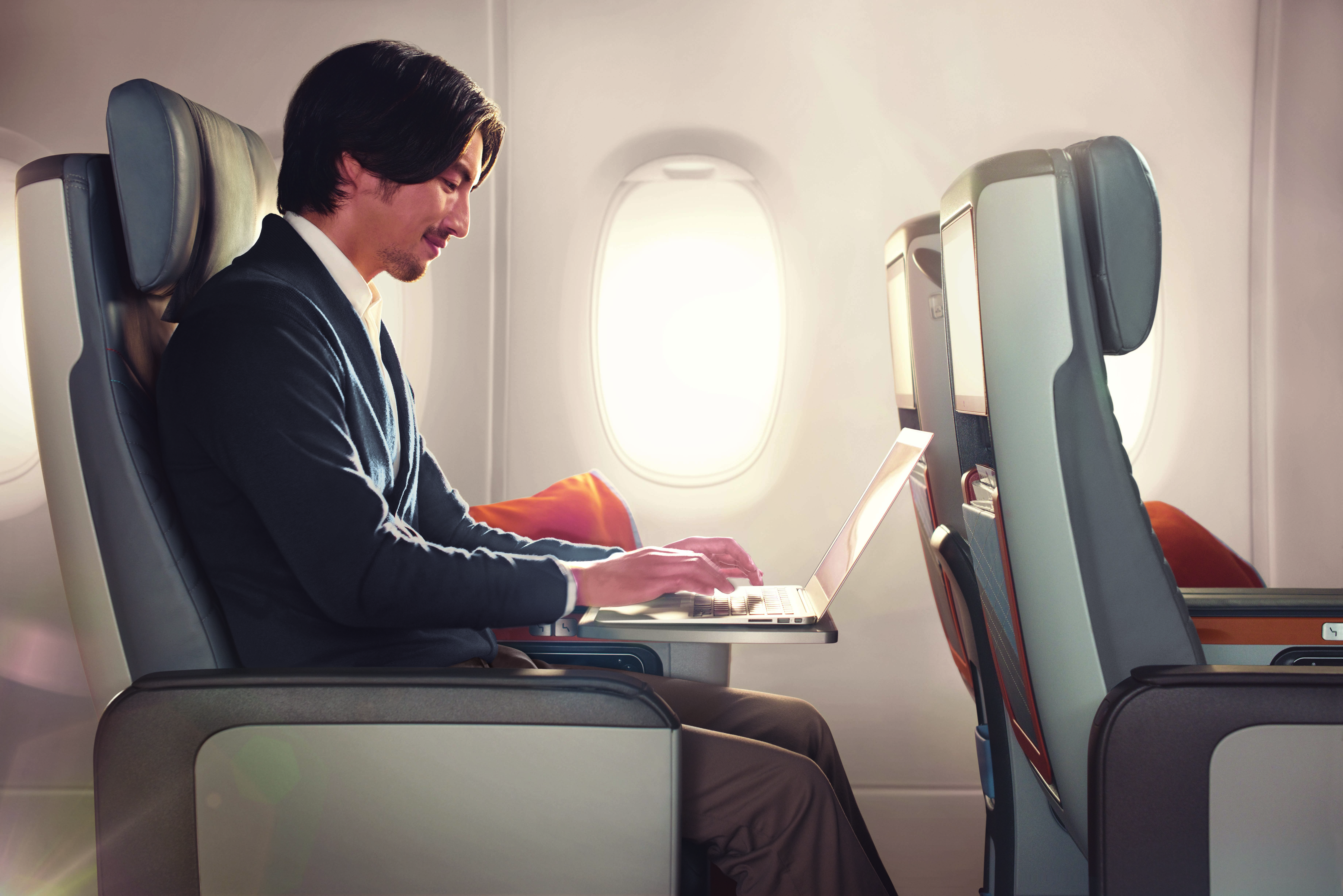 Asian male laptop, Premium Economy Class, Singapore Airlines