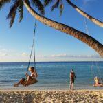 Schommelen aan een palmboom op Maafushi