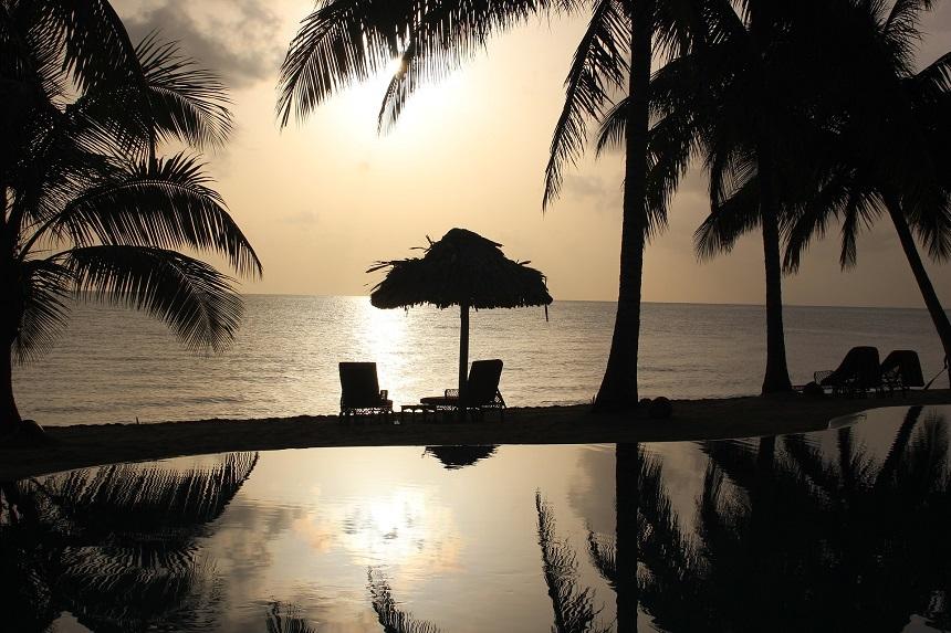 Pittoreske vissersdorpjes en hagelwitte stranden met palmen maken het zuiden een perfecte locatie om een avontuurlijke reis door Belize heerlijk af te sluiten