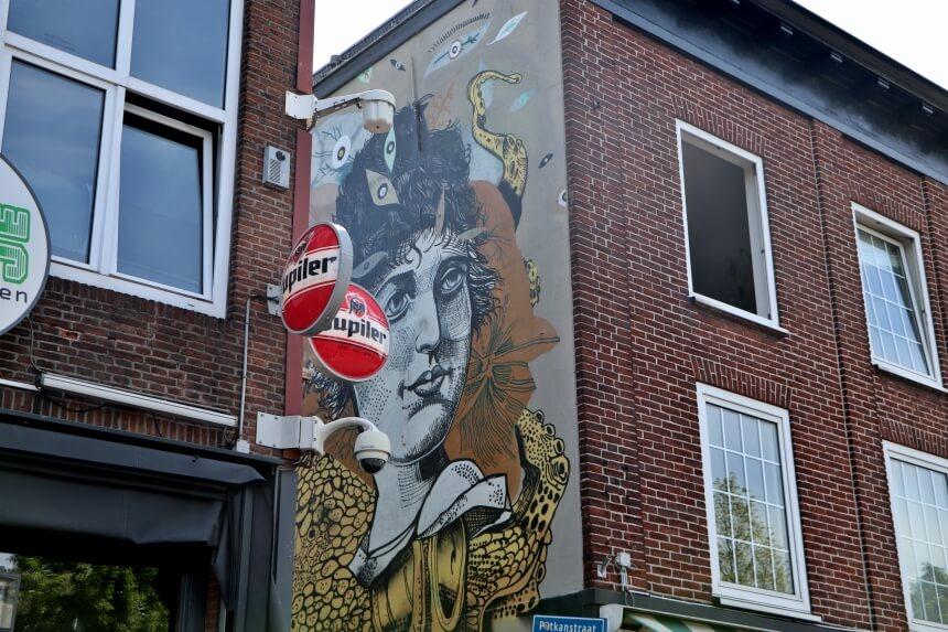 Diverse muurschilderingen staan symbool voor het nachtleven van Breda